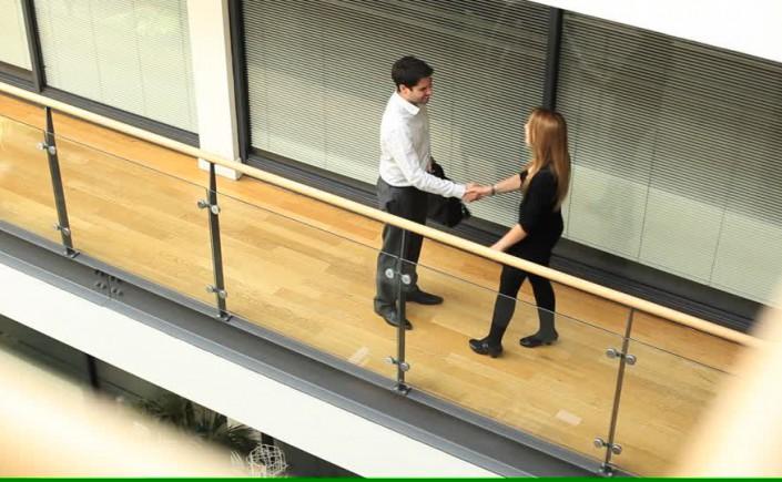 183170288-briefcase-corridor-glass-material-handshake